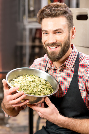 the brewer: Brewer with hops