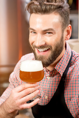the brewer: Brewer tasting beer Stock Photo