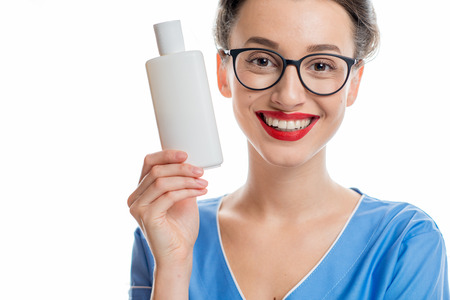 cosmetologist: Cosmetologist with bottle