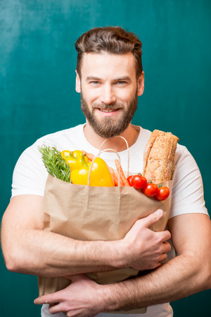 Man with bag full of food Stock Photo