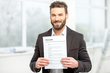 Man with resume paper Stock Photo