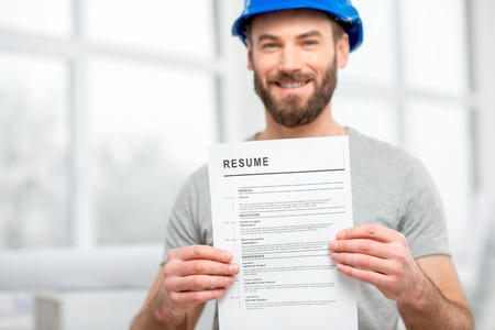 Builder searching a job Stock Photo