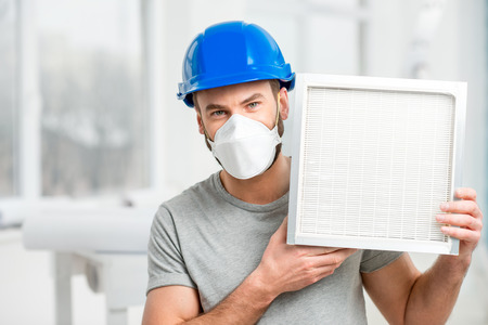 Worker with air filter 스톡 콘텐츠