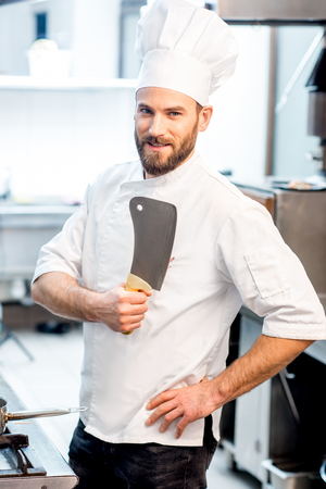 Chef cook at the kitchen