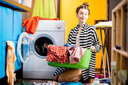Woman washing clothes at home