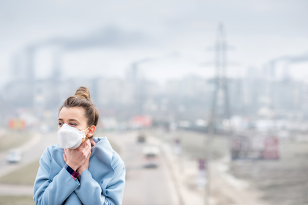 Woman with mask in the city