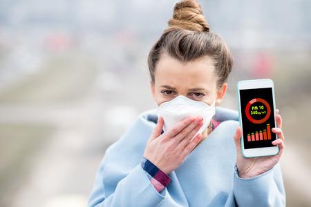 Woman measuring airpolution