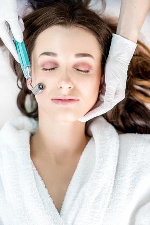 Womans facial treatment Stock Photo