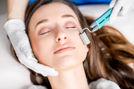 Womans facial treatment Stock Photo