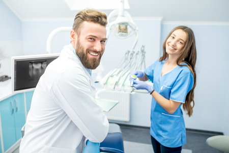 Dentist with assistant at the dental office