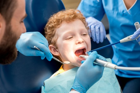 Childrens dental procedure Stock Photo