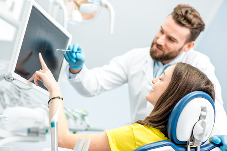Young woman on the consultation at the dental office