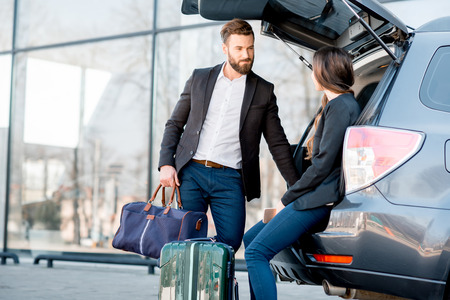 Business couple traveling by car Stock Photo