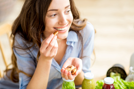 Woman eating nuts Stock Photo