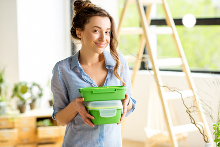 Woman with lunch boxes