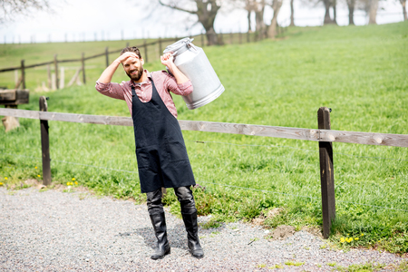 Farmer with milk outdoors Stock Photo