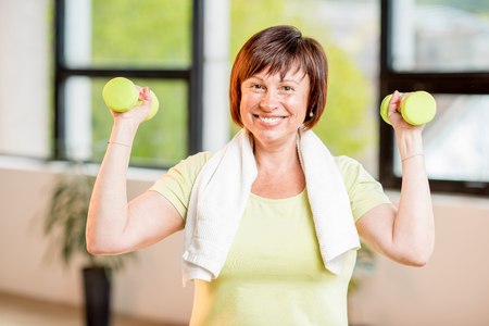 Older woman exercising indoors