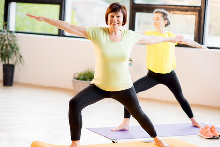 Young and older women doing yoga