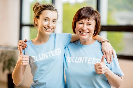 Young and older volunteers indoors Stock Photo