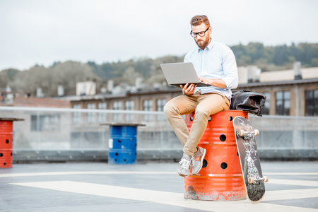 Businessman with laptop on the rooftop