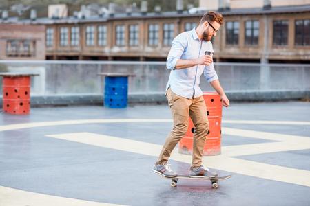 Businessman skateboarding on the rooftop