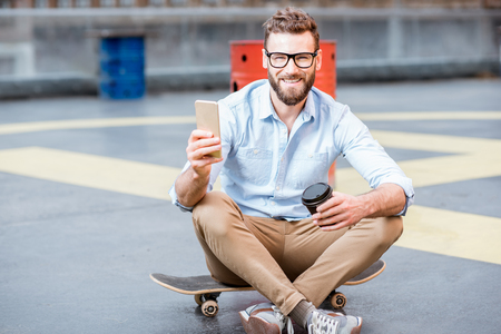 Businessman with smart phone on the rooftop