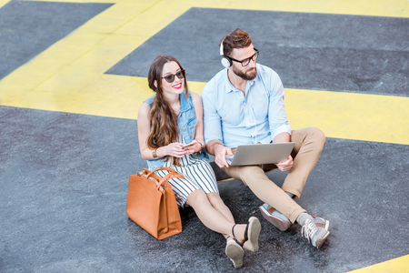 Business couple working outdoors on the heliport ground Stock Photo
