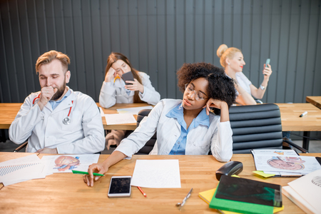 Medical students at the boring lesson Stock Photo