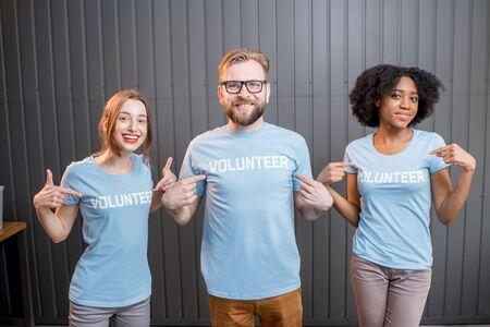 Happy volunteers indoors Stock Photo
