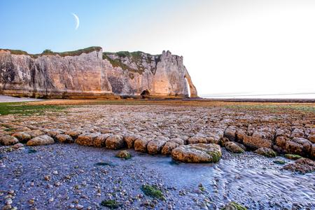 Landscape view on the rocky coastline in Etretat