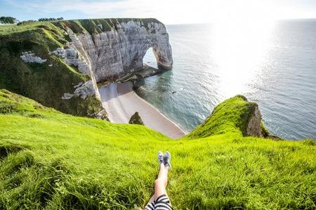 Rocky coastline with womens legs