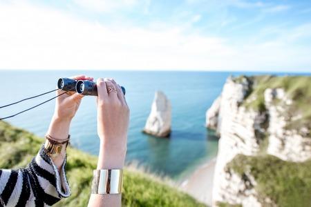 Watching with binoculars near the ocean