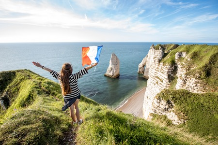 Woman with french flag outdoors Stock Photo