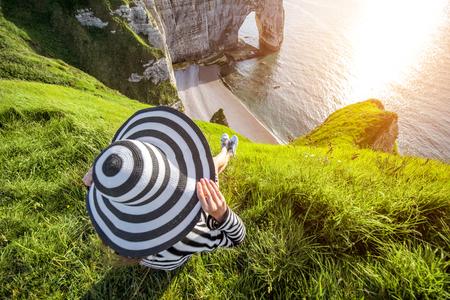 normandy: Woman on the rocky coastline