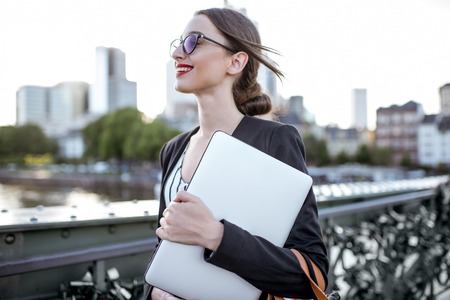 Businesswoman with laptop outdoors Stock Photo
