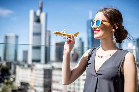 am: Woman with toy airplane in Frankfurt Stock Photo