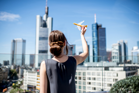 Woman with toy airplane in Frankfurt Imagens
