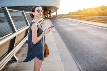 Businesswoman outdoors on the road