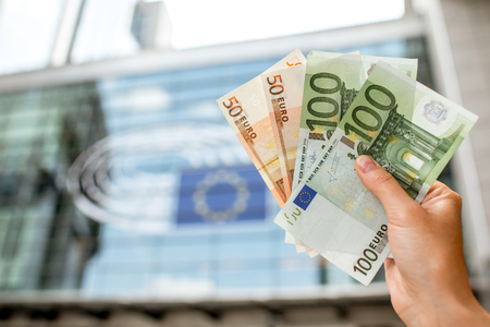 Holding euro banknotes