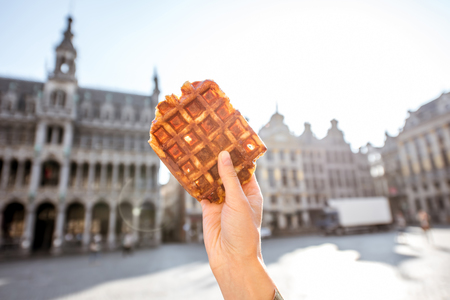 bruxelles: Holding belgian waffle outdoors