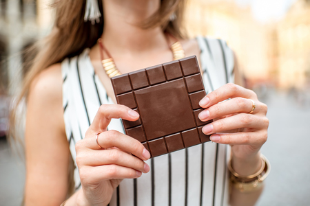 Holding a chocolate bar in Brussels