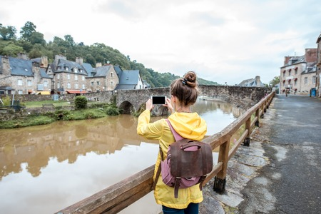 Woman traveling in french town Dinan