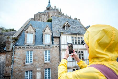 mont saint michel: Woman traveling in Mont Saint Michel