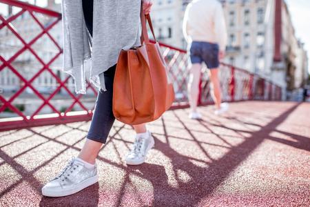 Businesswoman with bag on the bridge