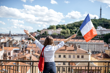 Woman with french flag in Lyon
