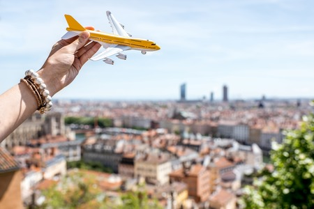 Airplane on the Lyon city background Stock Photo