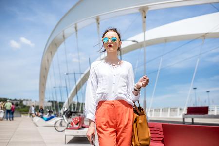 Woman on the modern bridge in Lyon