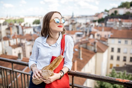 Woman with baguette in Lyon