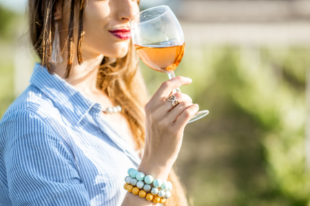 Woman tasting wine outdoors