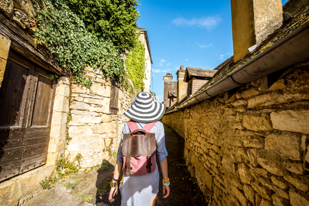 Woman traveling in La Roque Gageac village, France